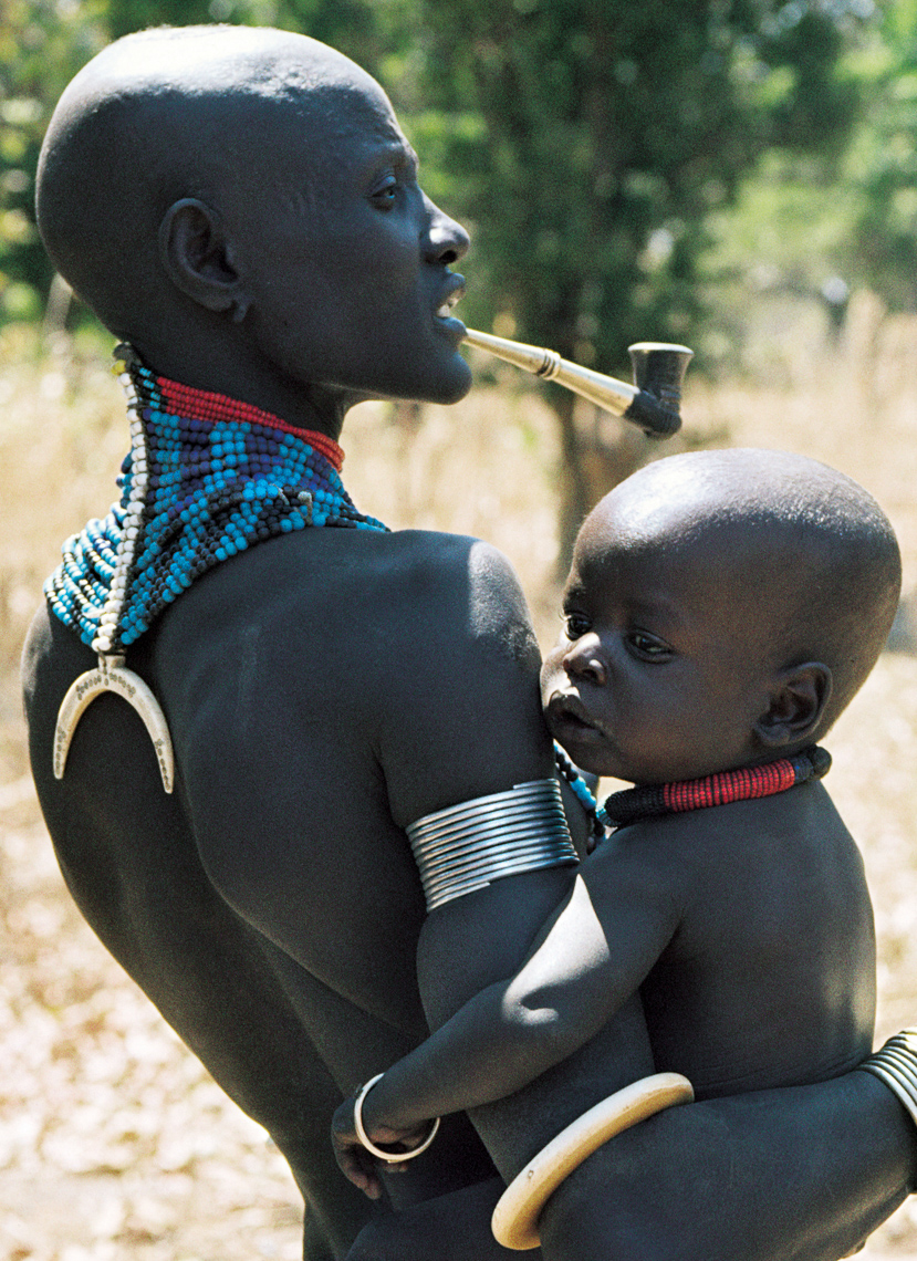Dinka Mother Carrying her Child