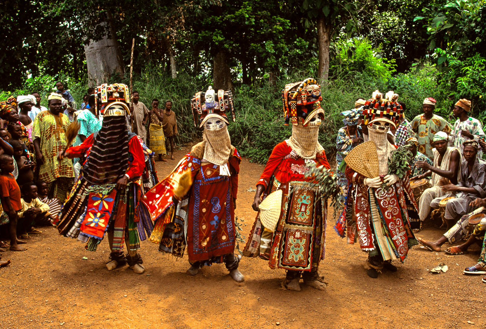 Oro Efe Masks Emerging from the Sacred Forest