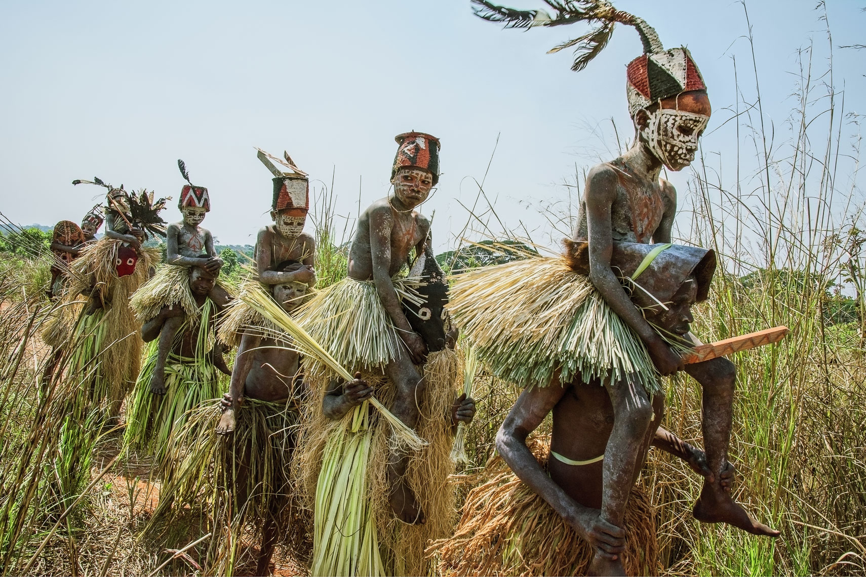 Salampasu Initiates Carried out of the Sacred Forest by Masked Guardians, D. R. Congo