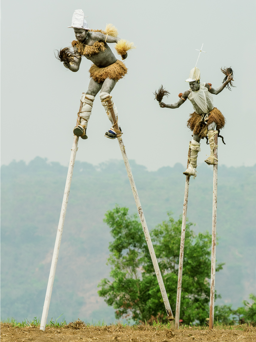 "Pende ""Tall men walking"" Stilt Dancers, Gungu, D.R. Congo"